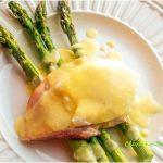 Hollandaise Sauce served over Asparagus, Ham, and Poached Eggs