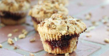 Peanut Butter and Jelly Muffins, made with Jif Cinnamon Peanut Butter!