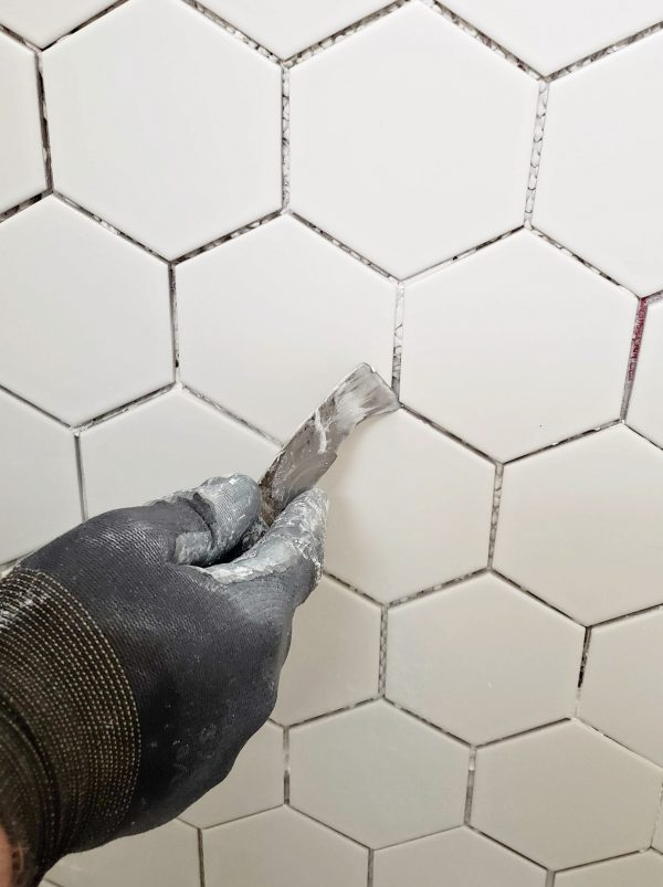 Scrape away thinset before grouting