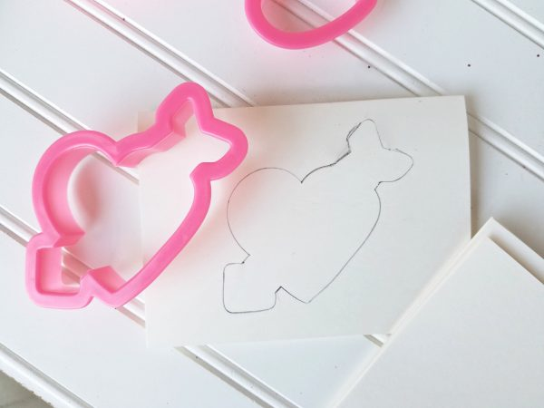 Using cookie cutters to template homemade Valentine's Day cards